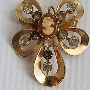 Vintage pin shape of butterfly with cameo